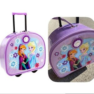 Disney Store exclusive Anna and Elsa luggage bag